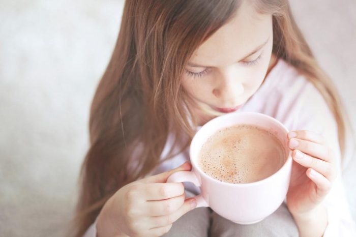 child drinking hot chocolate