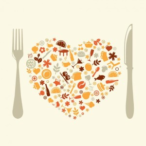 image of a fork and knife with a heart filled with food