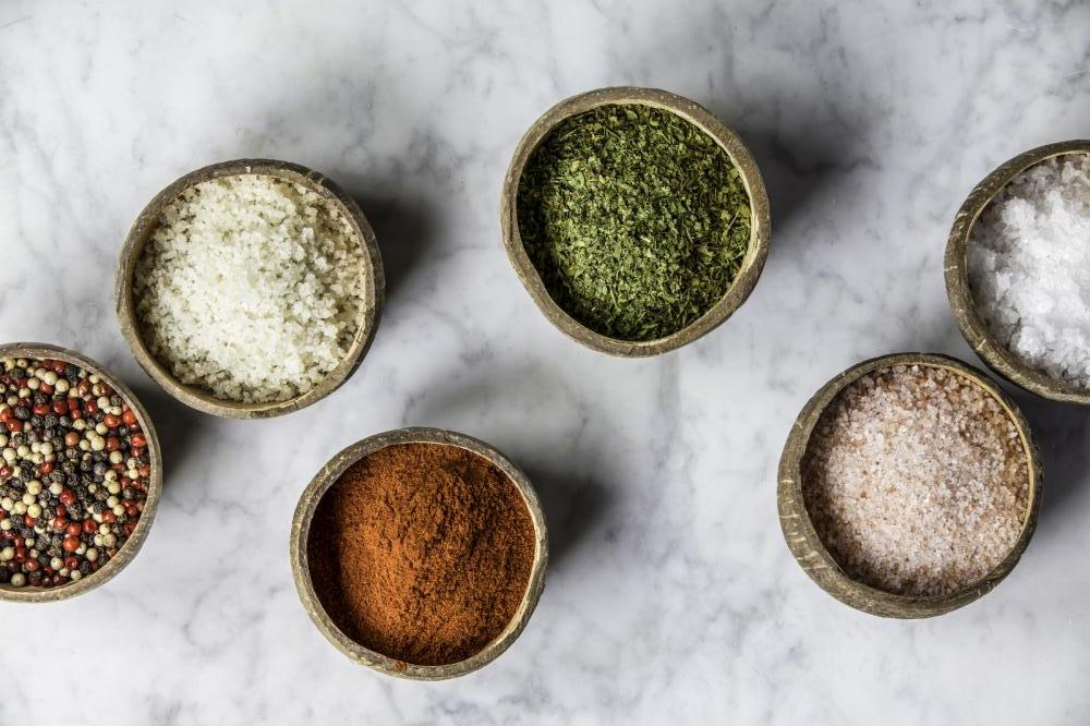 salt and herbs in small bowls