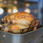 brined turkey in a hot pan